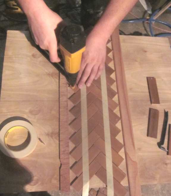 10. Glue then nail your slats into place
