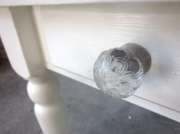 22. Put a decorative knob on the drawer to give this herringbone table project a finished look