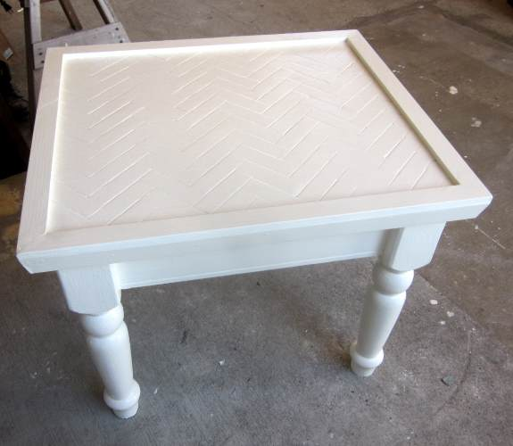 19. Once decorative trim is in place paint one more final coat of paint, three coats total on the tabletop itself