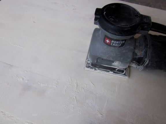 After table top is dry, sand evenly