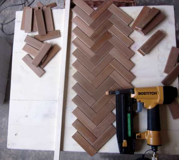9. Put guide rails along either side of the center line, and lay the first line of herringbone