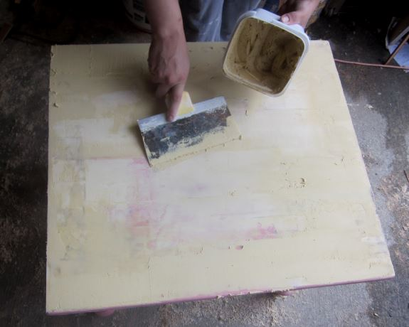 3. Fill in any uneven spots on the table top with wood filler